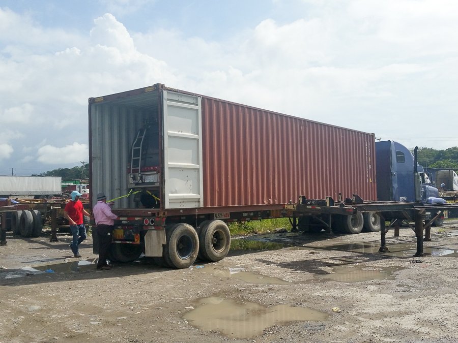 Loading The Container - Darien Gap Shipping